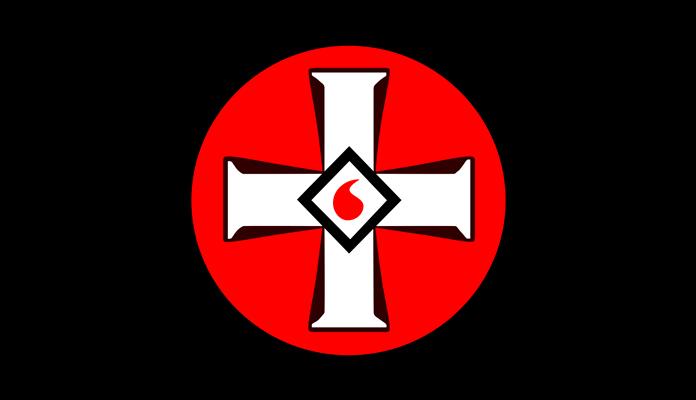 Emblema del Ku Klux Klan: una cruz en círculo con una gota de sangre en el centro