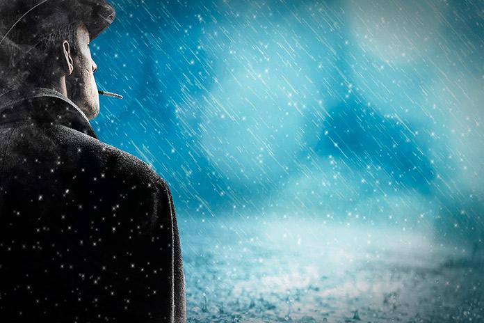 Hombre contemplando la lluvia